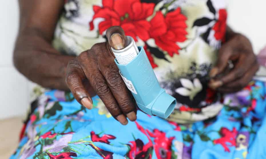 Indigenous woman holds asthma puffer