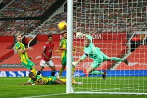 Sam Johnstone of West Bromwich Albion saves from Marcus Rashford of Manchester United .