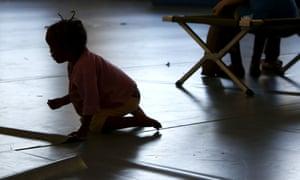 An asylum seeker's child plays inside a hall in Rosenheim, southern Germany.
