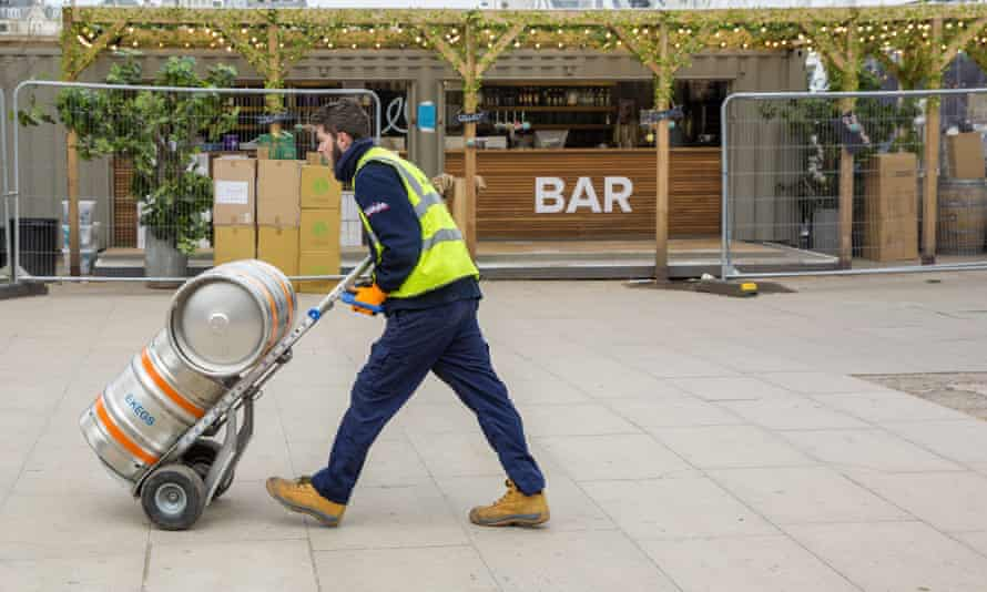 An outdoor bar stocks up with beer in time for reopening.