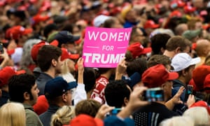 A woman holds up a sign at a rally in Cleveland, Ohio, on 5 November where Donald Trump was speaking.