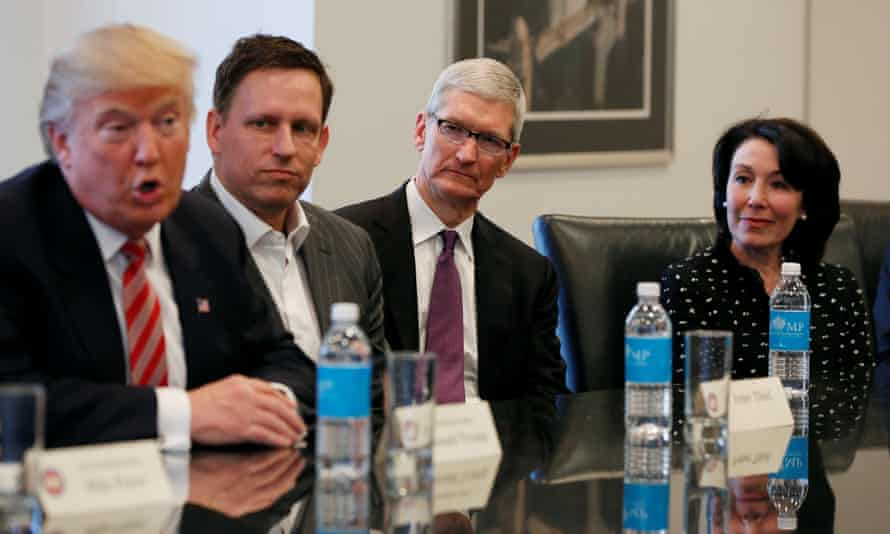 Donald Trump speaks as PayPal co-founder and Facebook board member Peter Thiel, Apple CEO Tim Cook and Oracle CEO Safra Catz listen.