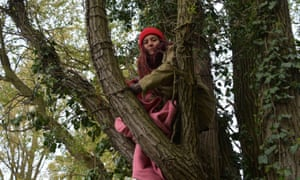 An Extinction Rebellion protester up a tree in Colne Valley