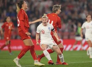 Beth England celebrates after scoring England's seventh goal.