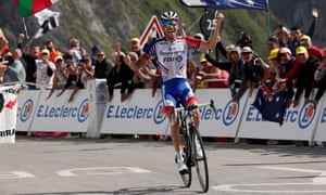 Thibaut Pinot celebrates his win as he crosses the finish line.