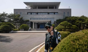 A soldier stands before 'Peace Hall', the venue of an upcoming summit between South Korean president Moon Jae-in and North Korean leader Kim Jong-un.