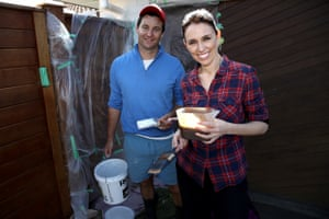 Labour party leader Jacinda Ardern and her partner Clarke Gayford paint the fence of their Pt Chevelier house on election day, September 23, 2017 as New Zealand voters head to the polls to elect the 52nd Parliament of New Zealand.