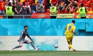 Roman Yaremchuk scores Ukraine's second goal as North Macedonia supporters watch on.