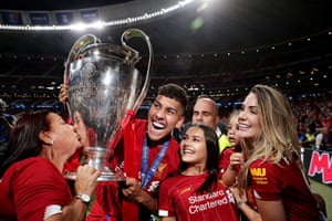 Roberto Firmino and his family celebrate Liverpool's victory over Tottenham Hotspur in the 2019 Champions League final.