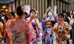Kimono-clad holidaymakers take commemorating photos at Asakusa, Tokyo downtown, Japan, 23 November 2020, the last day of the three-day holidays.