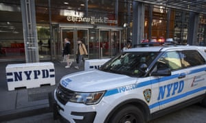 NYPD vehicles parked outside the office of the New York Times. Security is being ramped up after explosive devices were sent to top Democrat politicians and to CNN headquarters