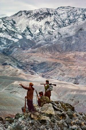 Logar province, 1984: Three mujahideen on a mountain in the Hindu Kush range.