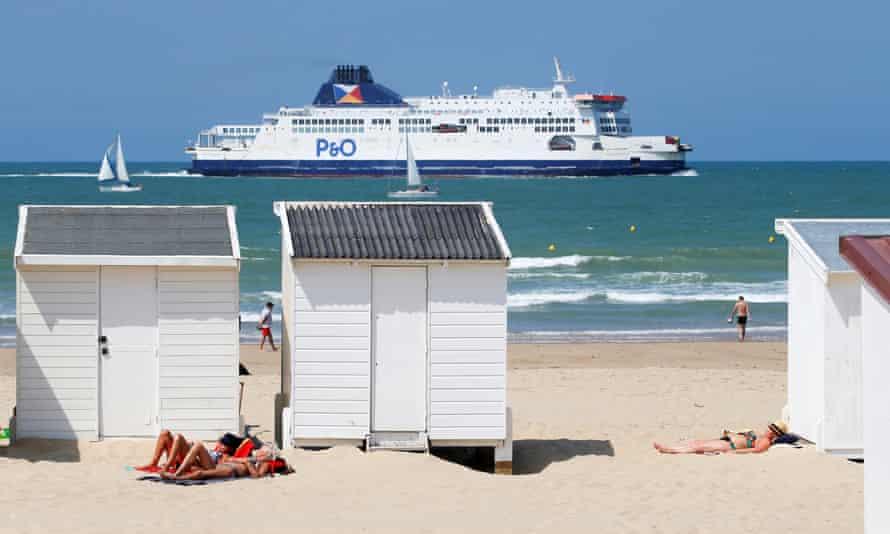 A P&O ferry sails past the beach in Calais