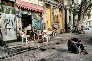 Locals outside a bar in the neighbourhood of Lapa, Rio de Janeiro.