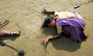 A woman mourns the death of a loved one killed in the Boxing Day tsunami in Tamil Nadu, southern India, in 2004.