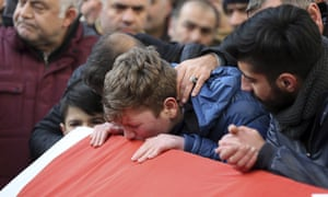 Family members and friends mourn as they attend funeral prayers for Ayhan Akin, one of the nightclub victims, in Istanbul