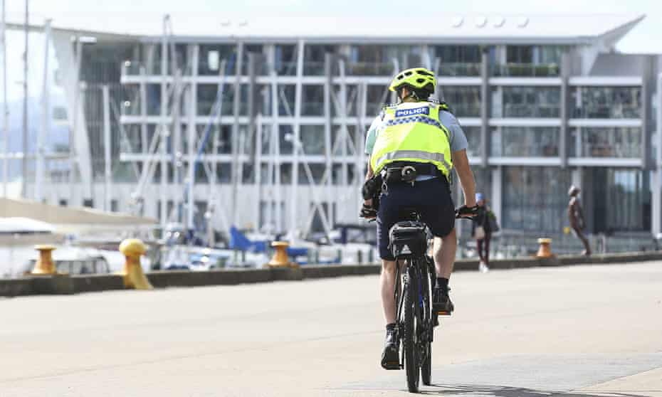 A police officer on patrol during the first day of a nationwide lockdown on March 26, 2020 in Wellington