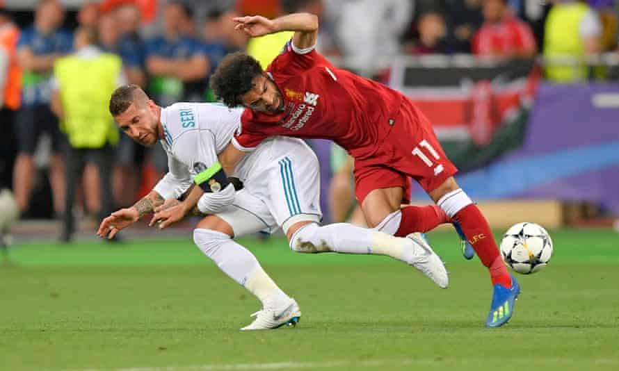 Sergio Ramos drags Mohamed Salah to the turf