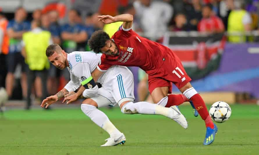 Sergio Ramos appears to press Mo Salah's right arm to his body, ending the Liverpool striker's participation in the Champions League final which Real went on to win 3-1.