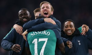 Harry Kane – who was watching from the stands – celebrates with Moussa Sissoko after Spurs beat Ajax in the Champions League semi-final.