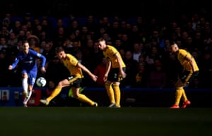 Chelsea's Eden Hazard finds a route past three Wolves players.