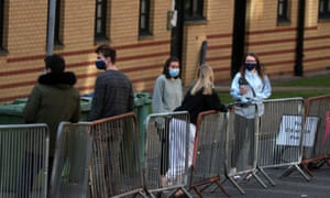 Glasgow University students queuing as they arrive for testing at a pop-up test centre last month