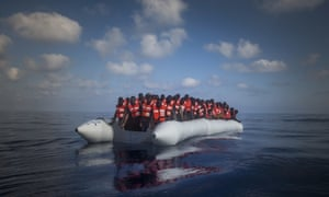 About 150 refugees and migrants wait for help during a rescue operation on the Mediterranean Sea off Libya.