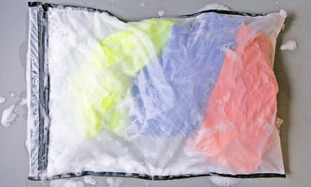 The Guppy Friend, a mesh laundry bag that goes into the washing machine. The bag captures shedding fibers as clothes are tossed and spun, preventing the fibers from escaping.