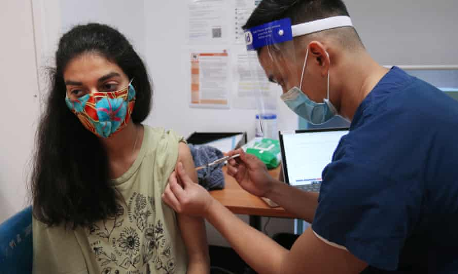 A nurse administers the Pfizer vaccine to a client at the St Vincent's Covid vaccination clinic in Sydney, Australia