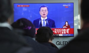 People watch a live broadcast of South Korean President Moon Jae-in.