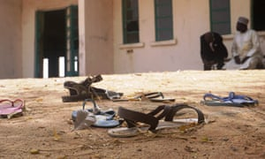 Sandals left behind in the yard of the Government Girls Science and Technical College on Thursday.