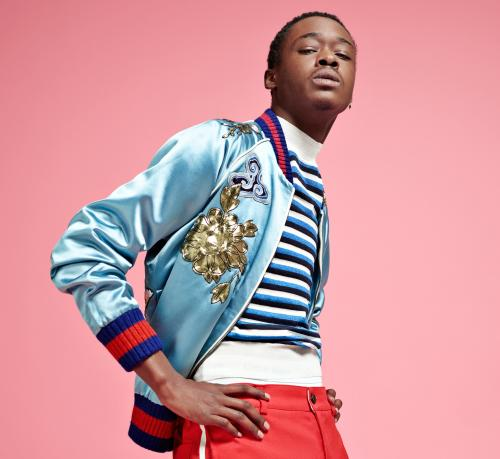 Ashton Sanders, star of Moonlight film, against a pink background