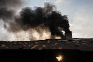 Black smoke emerges from a brick kiln where garment offcuts are used as fuel