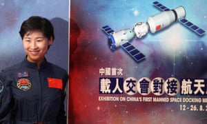 Chinese astronaut Liu Yang of the Tiangong-1 mission poses for photographs during the opening ceremony of an exhibition on China's first space station in 2012.