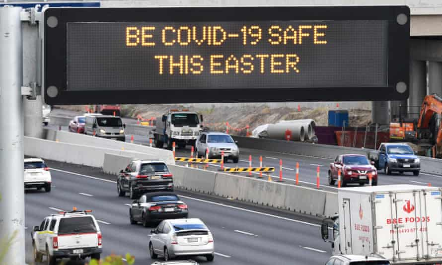A traffic sign displaying a COVID-19 safe message is seen on the Pacific Motorway in Brisbane