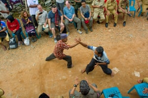 The expedition team enjoys a traditional Batak martial arts performance in a remote village.