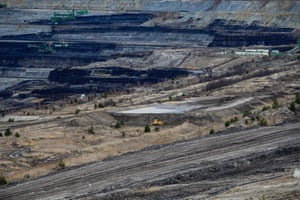 Excavators remove layers of earth to reach the lignite lying underneath the Turów open-pit mine