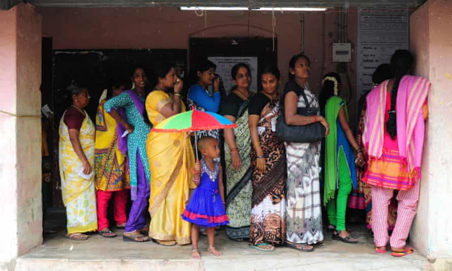 Indian voters queue at a polling station in Chennai on 16 May last year during voting in state assembly elections.