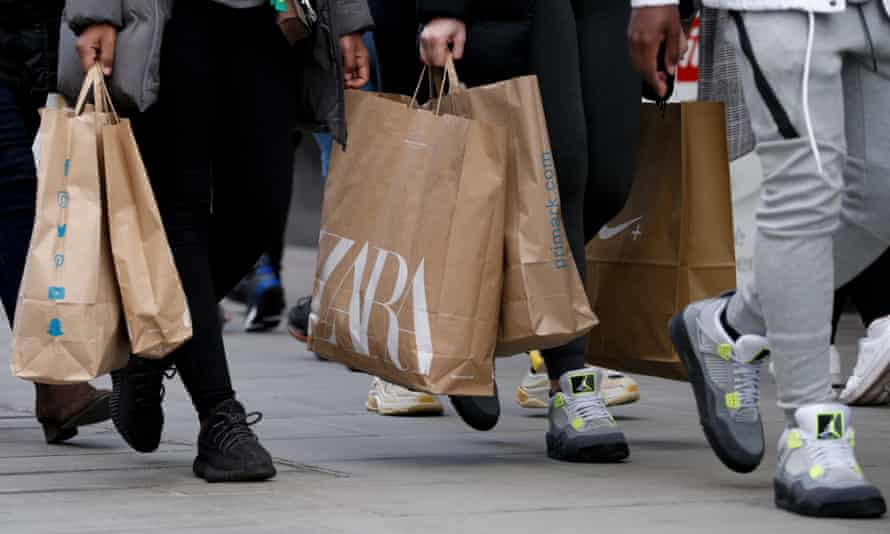 Shoppers carry bags along Oxford Street in London in April 2021.