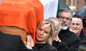 Gerry Adams and Michelle O'Neill, carry Martin McGuinness's coffin through the streets of Derry.