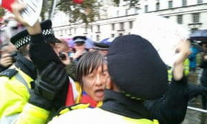 Shao Jiang and police at the human rights protest