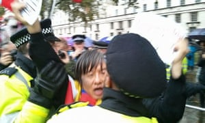 Shao Jiang is arrested by Metropolitan police officers.