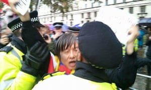 A still from the video of Shao Jiang's arrest in London for protesting during President Xi's state visit in 2015.
