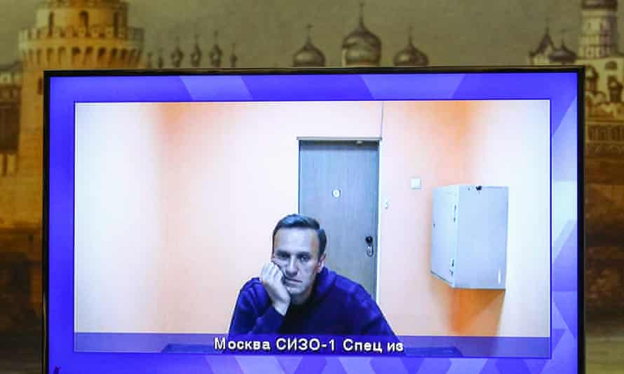 Alexei Navalny on screen in court as he followed the proceedings by video link from jail