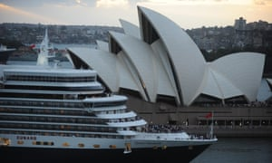 The Queen Elizabeth sails past the Sydney Opera House.