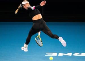 Melbourne, AustraliaDenmark's Caroline Wozniacki plays a shot between her legs during practice ahead of the Australian Open tennis tournament.