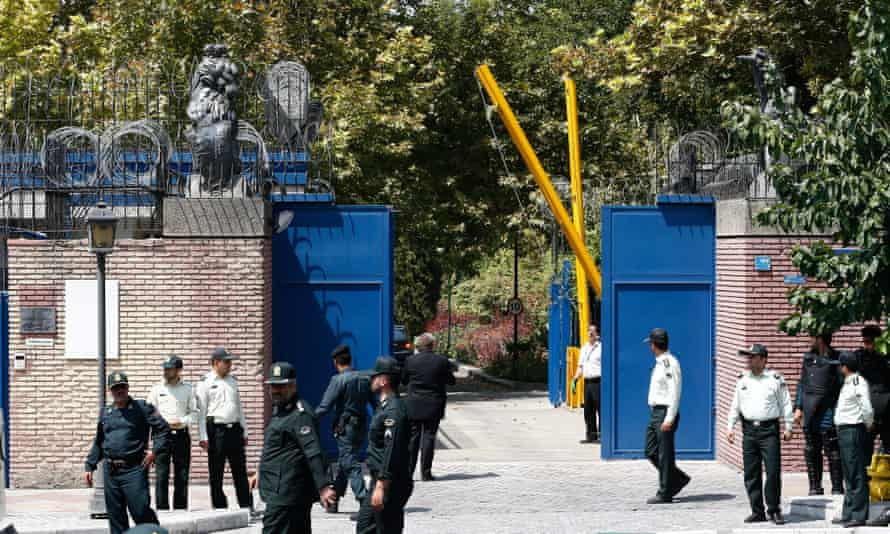 Iranian police stand guard outside the British embassy in Tehran after it opened in August 2015.