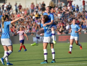 Manchester City's Tessa Wullaert (no25) is congratulated by her Keira Walsh after scoring the winning goal in the final minutes against Atletico de Madrid during the International Champions Cup third place match at in Cary, North Carolina during August 2019.