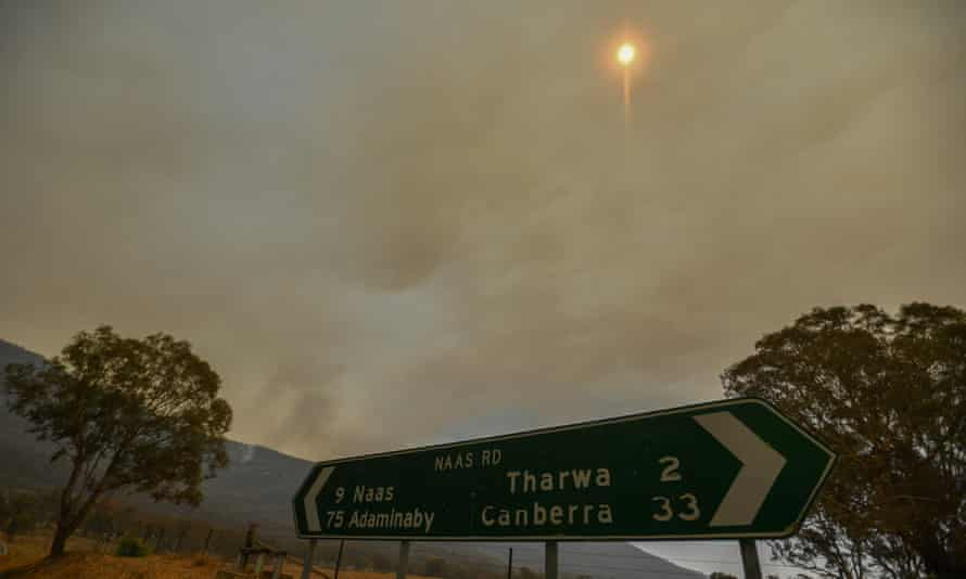 A bushfire burns behind a ridge near Tharwa Village, 30km south of Canberra.