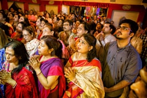Devotees at a community Durga Puja praying on the eighth day of the festival. It is marked by a grand evening arati (ritual of invocation of the goddess), which is believed to be the most important day of the festival.